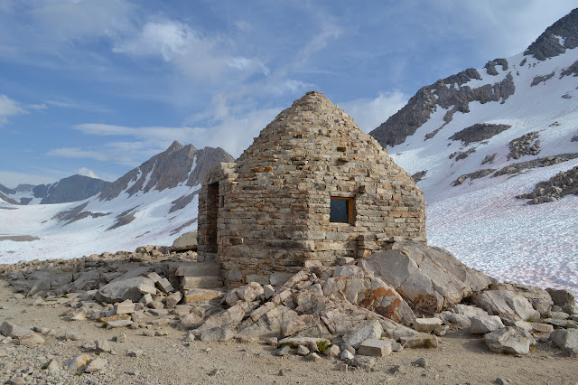 rock hut in a circle with a very pointed top