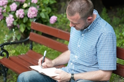 """Man Writing In Notepad"" by tiramisustudio FreeDigitalPhotos.net"