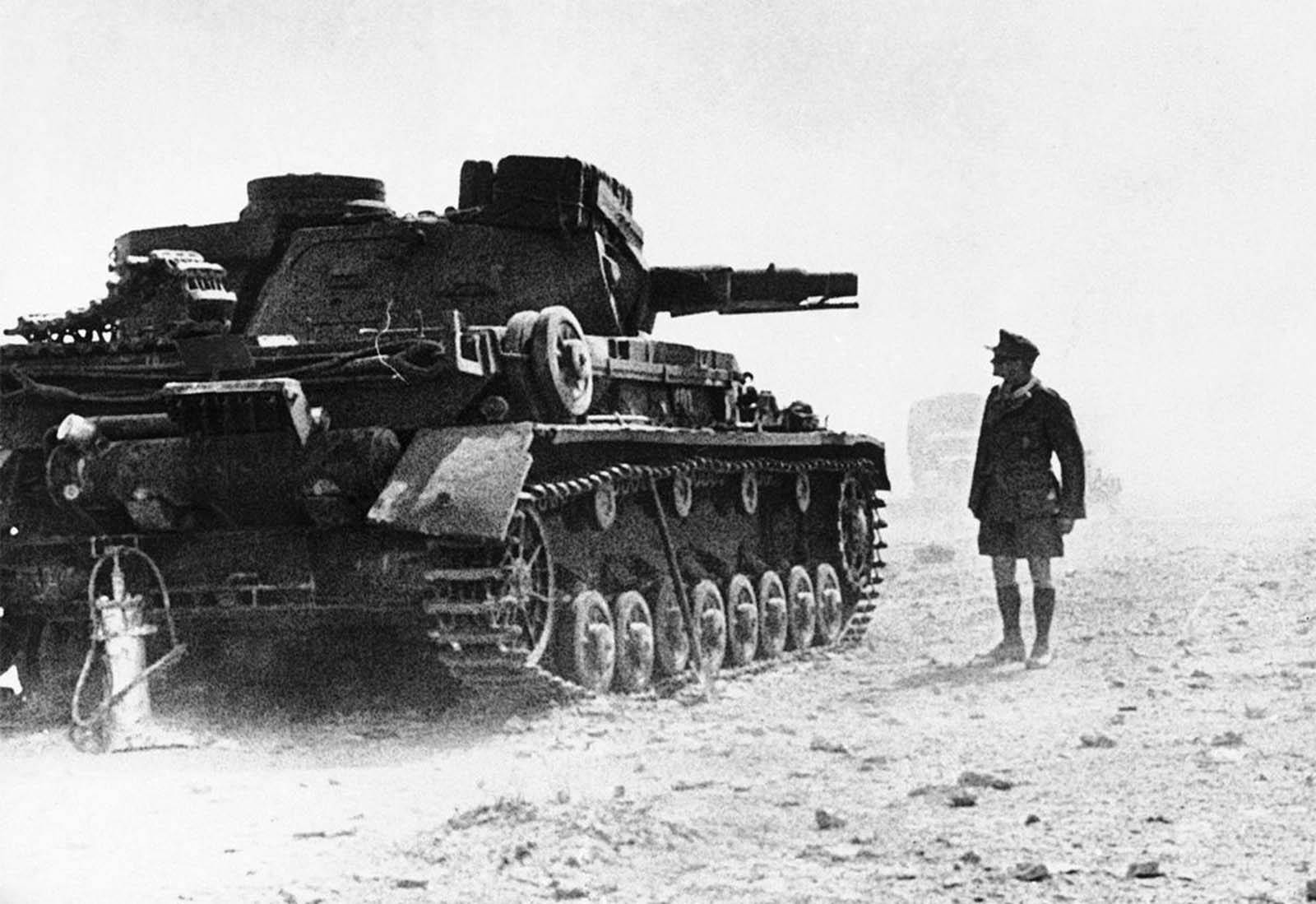 A huge Panzer IV German tank, part of the German expeditionary force in North Africa, halts in the Libyan Desert on April 14, 1941.