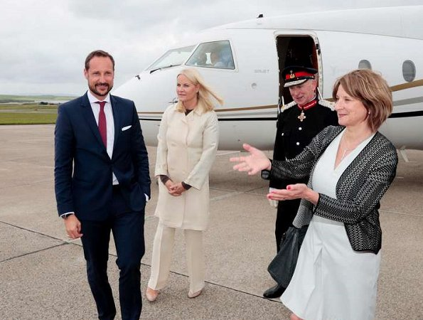 Crown Princess Mette-Marit and Crown Prince Haakon attended St. Magnus festival in Scotland. Prada dress, Christian Louboutin pumps