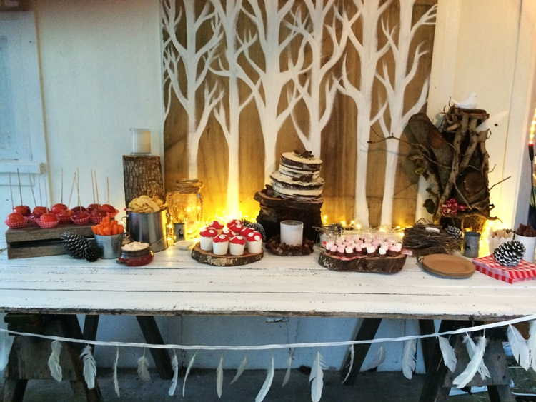 Woodland Campfire party - dessert trestle table with woodland backdrop