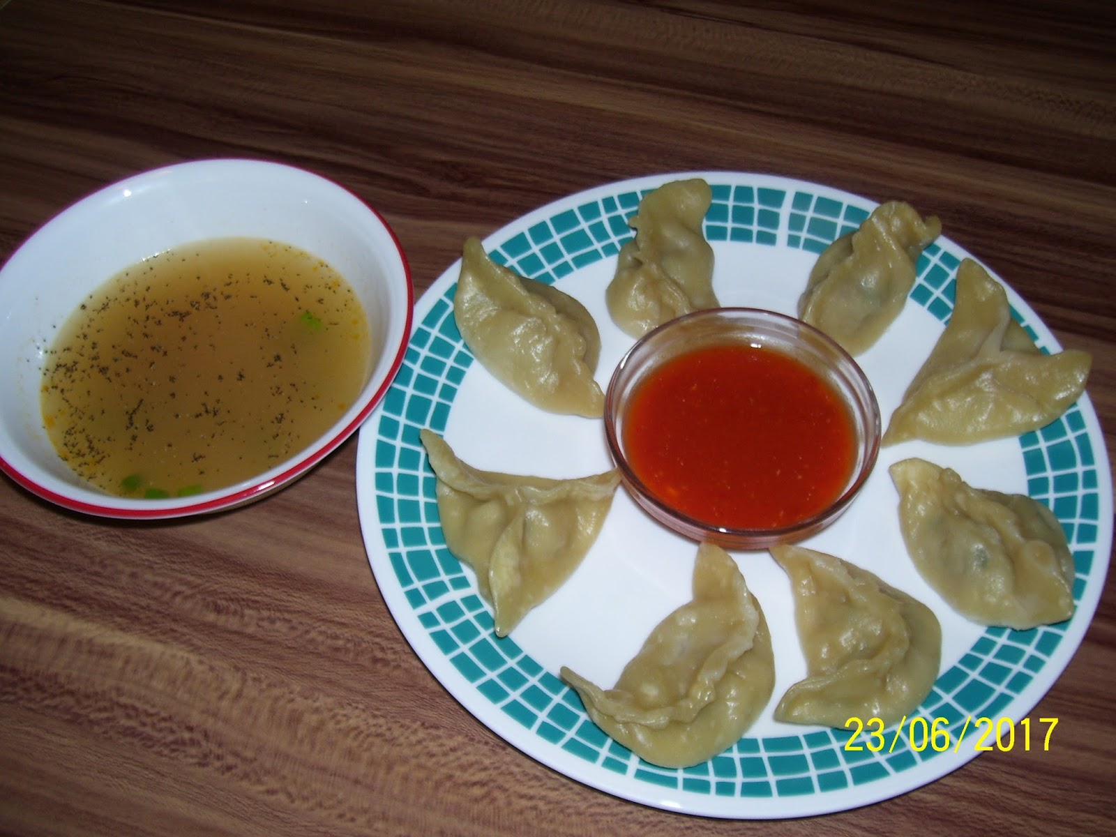 Kitchen with a purpose nepali steamed chicken momo with dipping sauce minced chicken garlic onion dry ginger powder cilantro and other aromatics from homemade momo masala or spice mixa recipe for spicy hot dipping sauce forumfinder