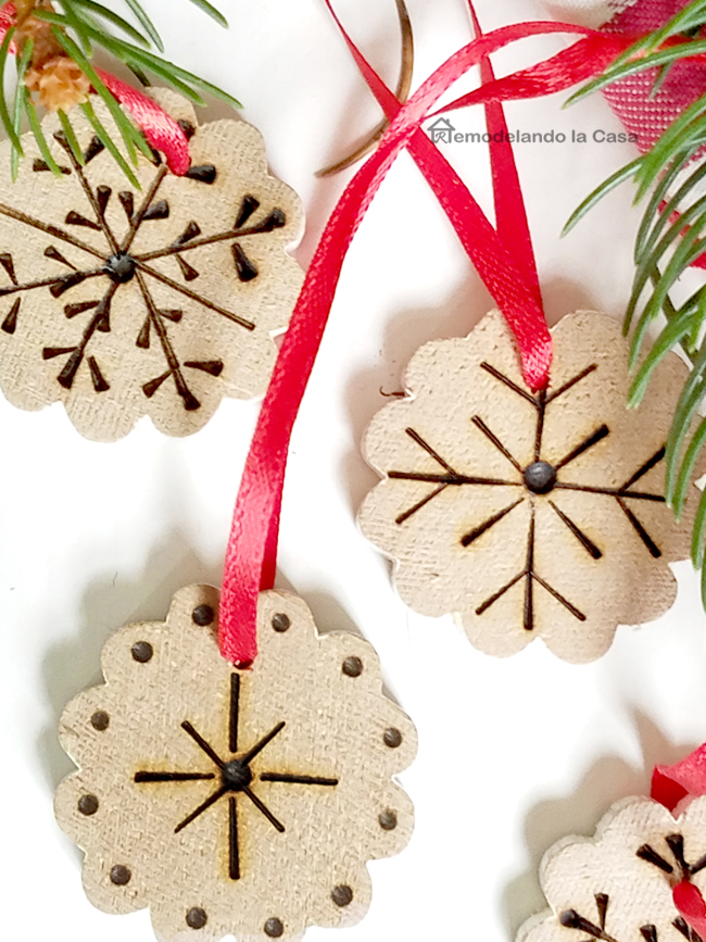 wood burned snowflakes with red ribbon