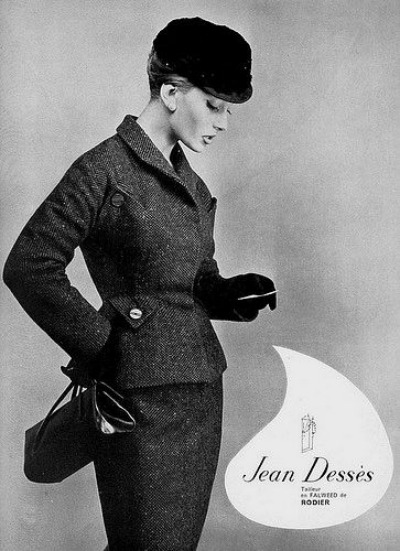 Model wearing suit designed by Jean Dessés in 1959 magazine advertisement
