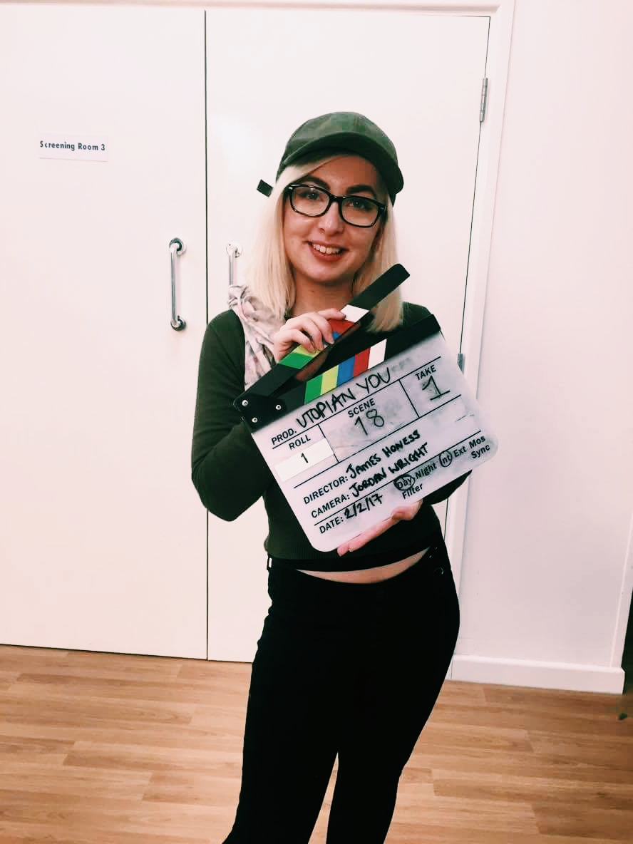 film student with clapper board