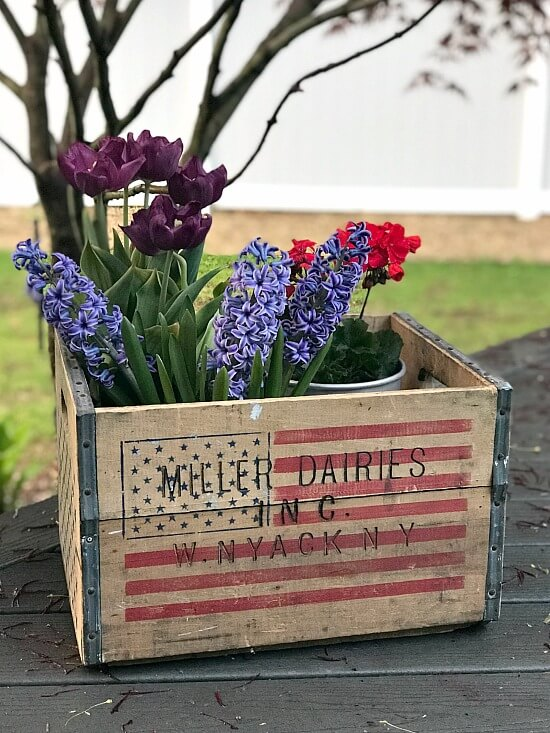 Crate filled with flowers for fourth of july