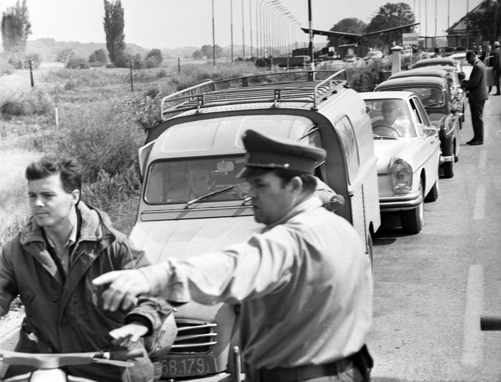 Czechoslovakian refugees flee the country, photographed here at the Austrian border, in autumn 1968.