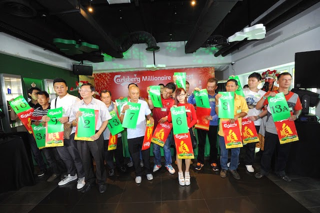 Carlsberg Millionaire contestants displaying their placement order which was determined through their selection of giant Ang Pau packets
