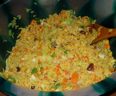 Mixing fried rice with vegetables