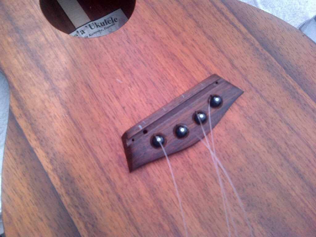 Drilling bridge hole for installing ukulele pickup