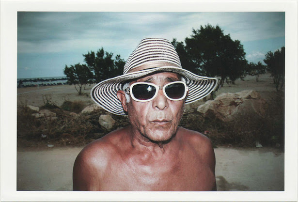 dirty photos - on the island of - photo of man with white glasses at the beach
