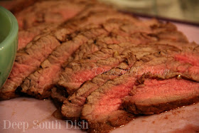 A beef broth, marinated flank steak, with Creole mustard, balsamic vinegar and herbs, prepared in the classic London Broil method, with a quick sear on a hot grill and sliced at an angle, against the grain, for a full flavored tender steak.