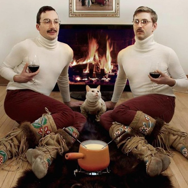 An unfortunate photo of two adult men dressed identically  with a cat and a fondue set. Attraction is Breed Specific. marchmatron.com