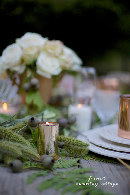 table setting with warm autumn tones copper and greens