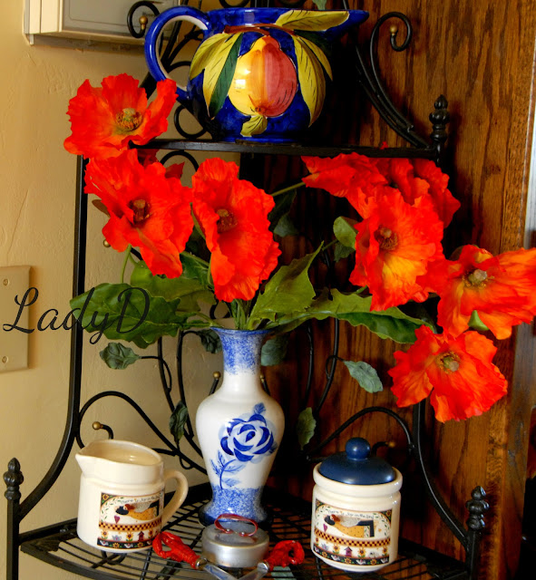 blue pottery with red flowers: LadyD Books