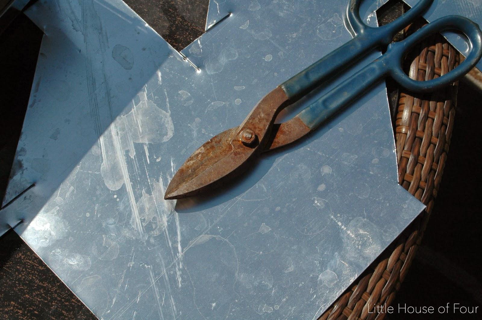 Sheet metal and tin snips for DIY bin pulls