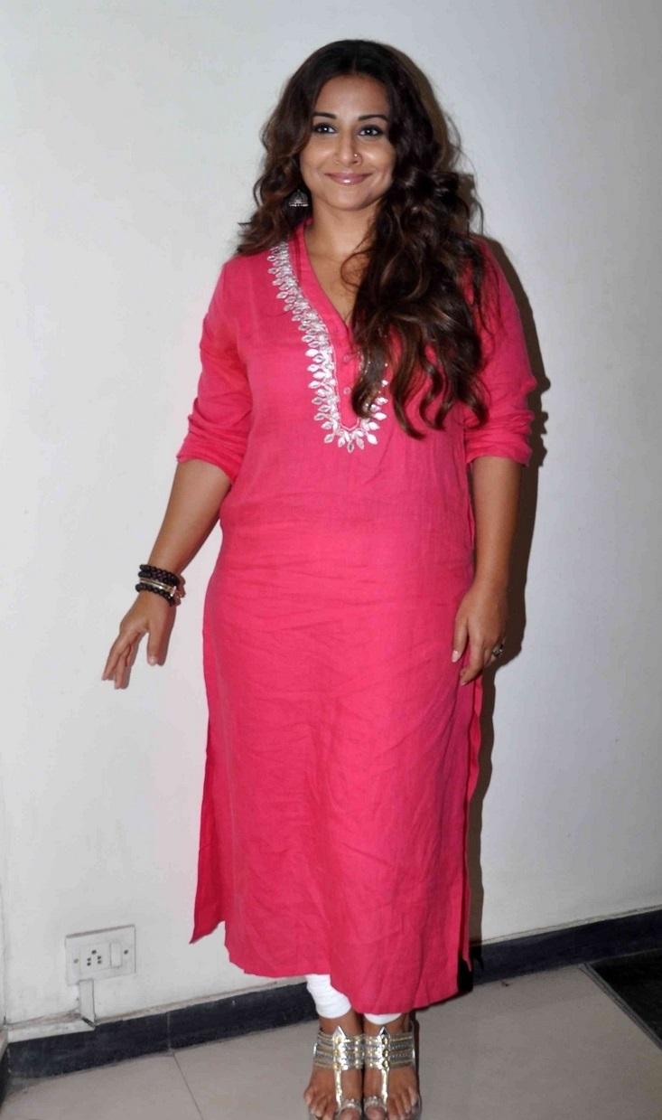 Actress Vidya balan Long Hair Stills In Red Dress