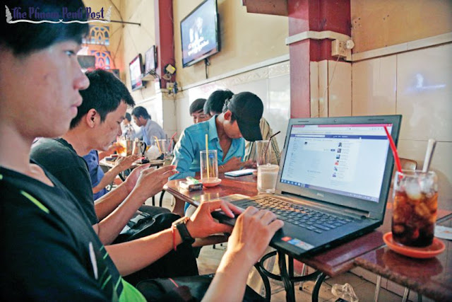 People browse the internet at a café in Phnom Penh earlier this year. Hong Menea