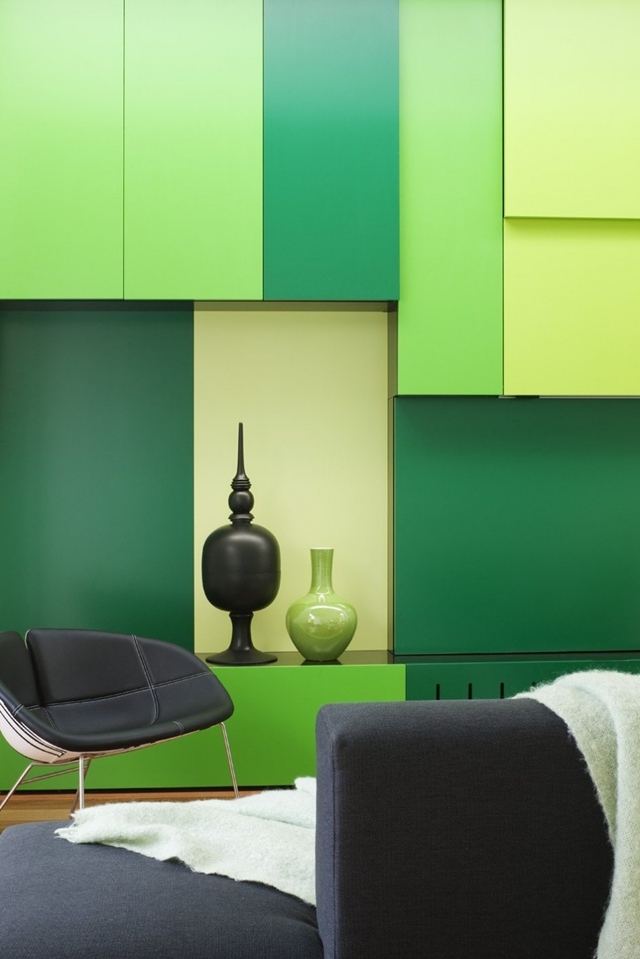 Four green colors on the living room wall