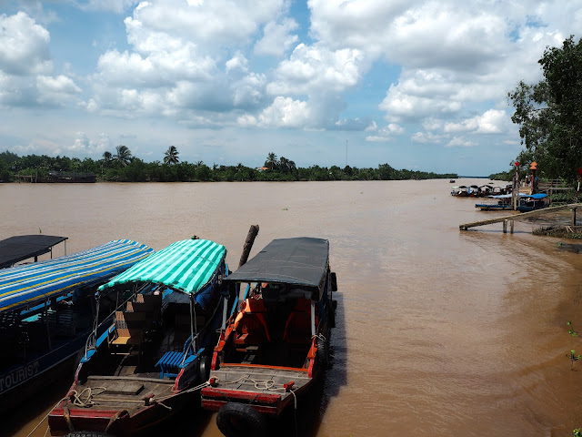Traditional wooden fishing boats on the Mekong Delta, Vietnam