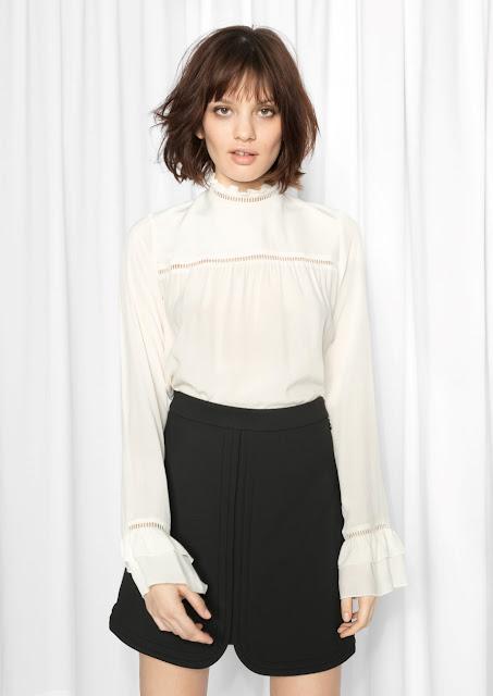 cream high neck blouse