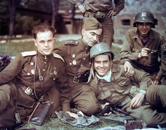 Soviet officers and U.S. soldiers during a friendly meeting on the Elbe River in April of 1945.