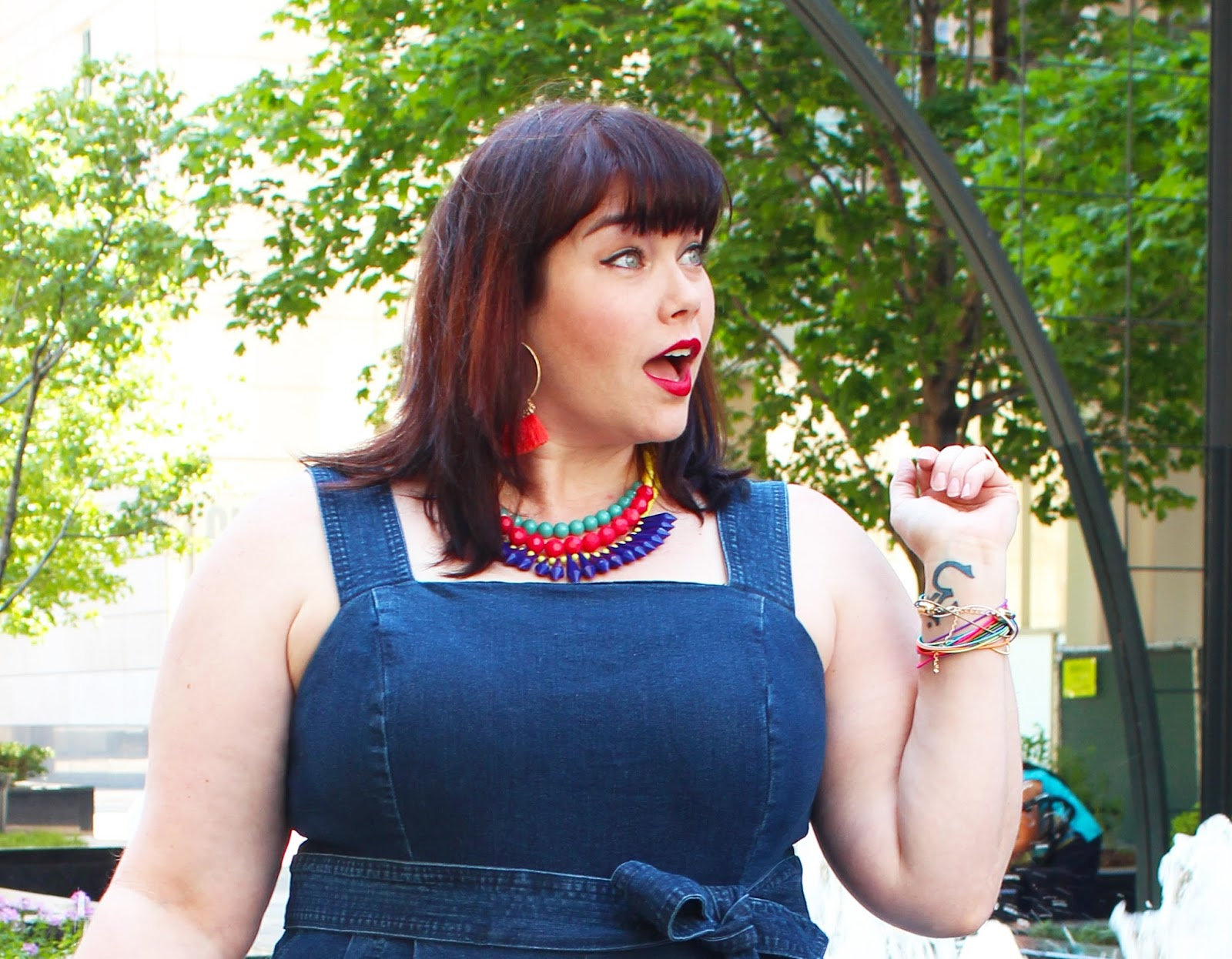 Plus Size Blogger Amber from Style Plus Curves in a cropped denim jumpsuit from Eloquii