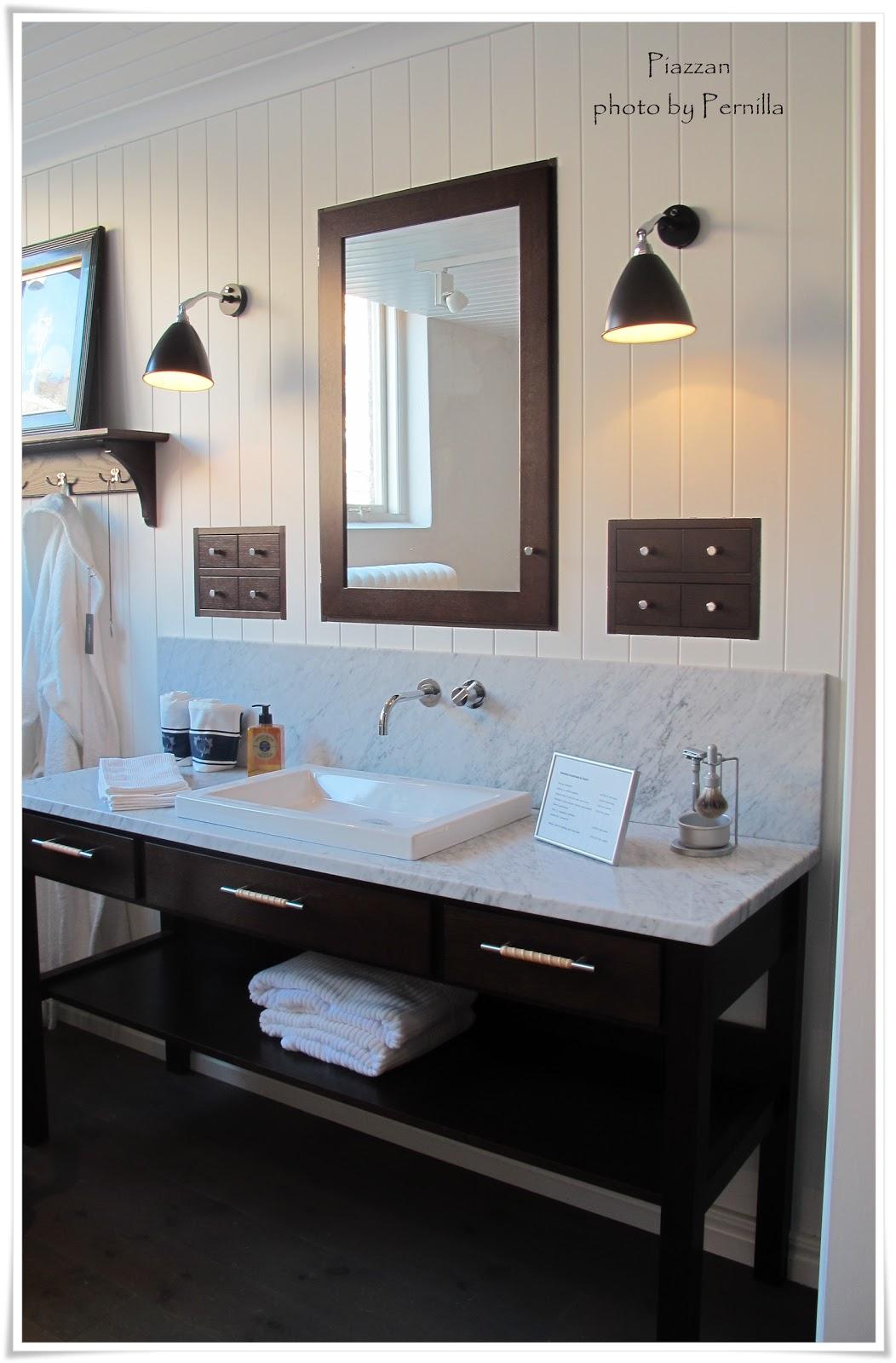 Piazzan: Carrarmarmor och snyggt badrum
