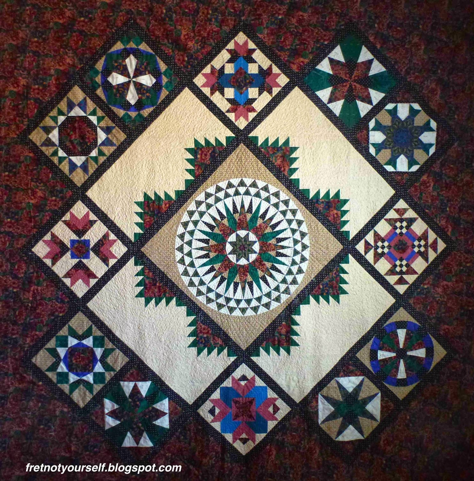Original design of traditional quilt blocks in green, black, pink, blue, tan and white