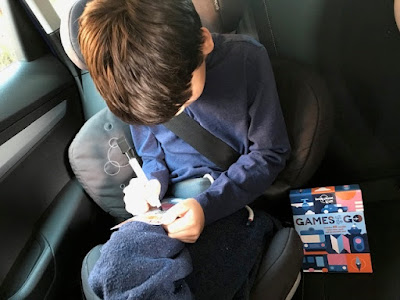 Child with Games on the Go in the car
