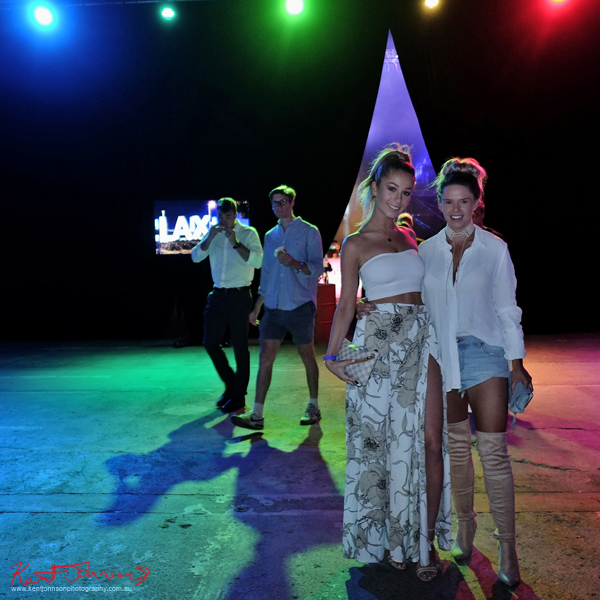 Outside the 'party tent' young women in white and denim. UE Boom 2 Launch at Carriageworks Sydney #PartyUp photographed by Kent Johnson for Street Fashion Sydney.