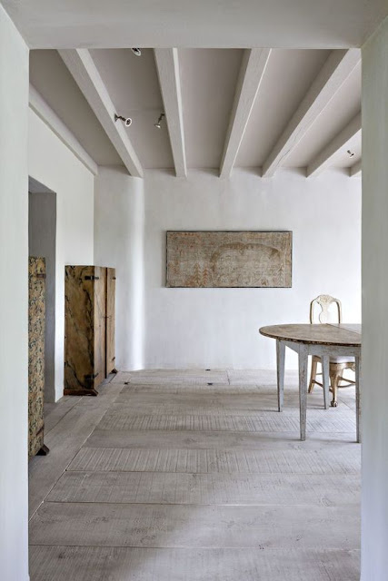 Minimal decor in modern farmhouse room with exposed rafters and organic slow living vibe - found on Hello Lovely Studio