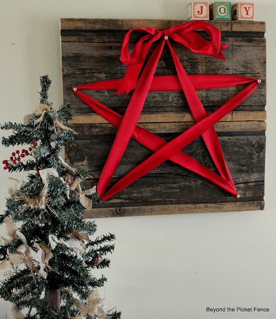 make a rustic and unique Christmas sign with some old barn wood and ribbon