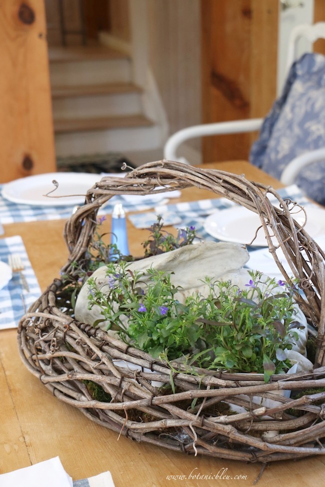 Protect dining tables from leaks in a French country floral centerpiece bunny basket