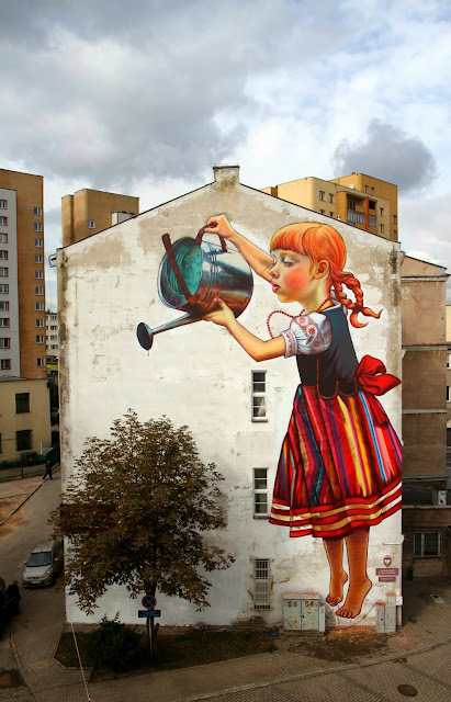 Polish Street Artist Natalia Rak Paints A New Mural On The Streets Of Bialystok For Folk On The Street. 2