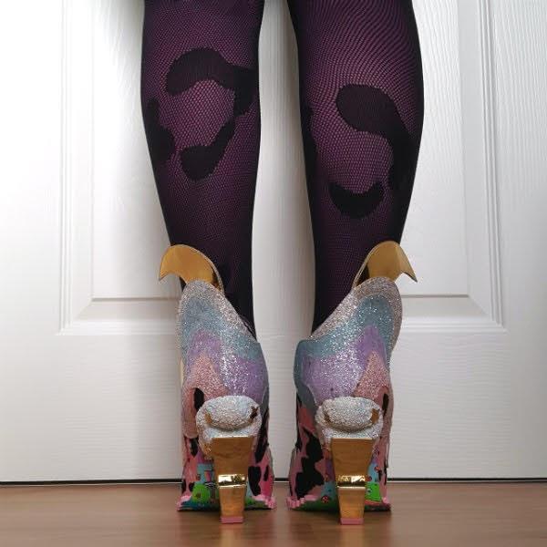 backs of legs wearing lightning bolt heeled shoe boots with glitter cloud detail