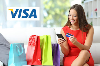 Photo of a woman shopping via cell phone