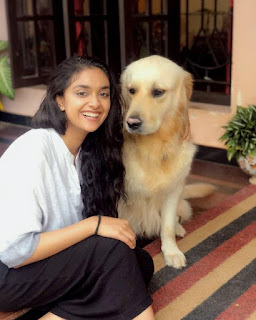 Keerthy Suresh with Cute and Awesome Lovely Smile with her Cute Dog