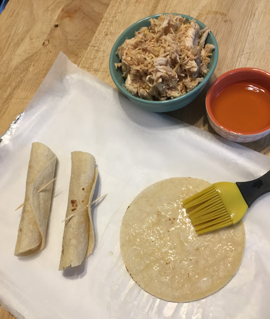 Chicken Taquitos being rolled