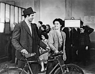 the father and his wife, happy at the start of the movie, directed by bicycle thieves, directed by vittorio de sica