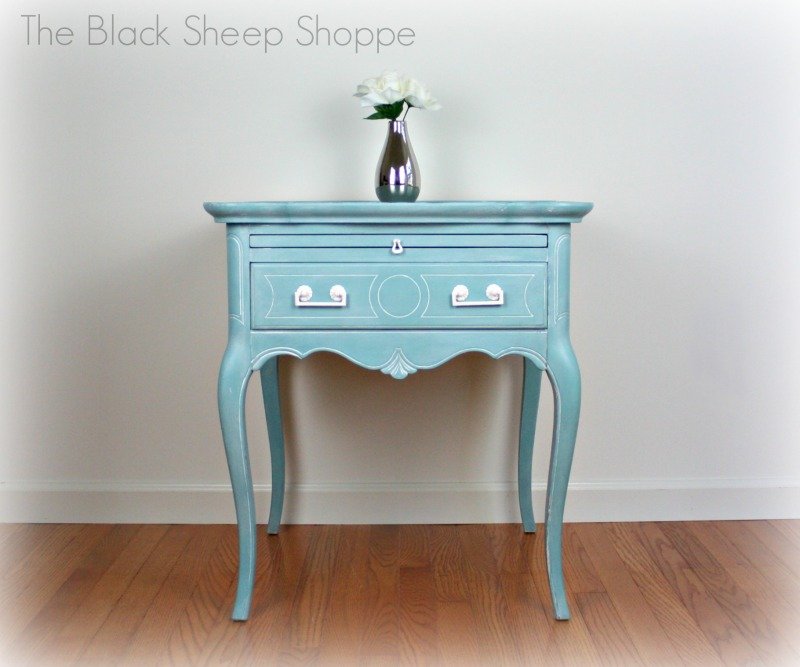 Side table painted in Provence blue with white highlights.