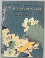 "Cover of ""The Boy Who Drew Cats,"" showing a boy drawing a cat."