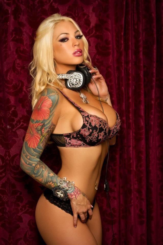 Sexy Tattooed Model And DJ Megan Daniels