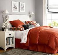 Habitación color naranja y gris