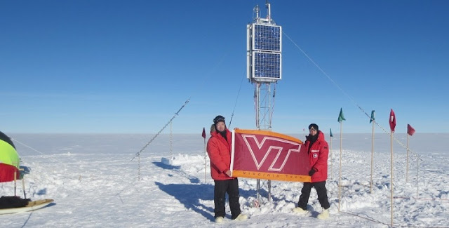 Zhonghua Xu (left) and Mike Hartinger represent Virginia Tech in front of solar panels at their base camp in Antarctica. Credit: Virginia Tech