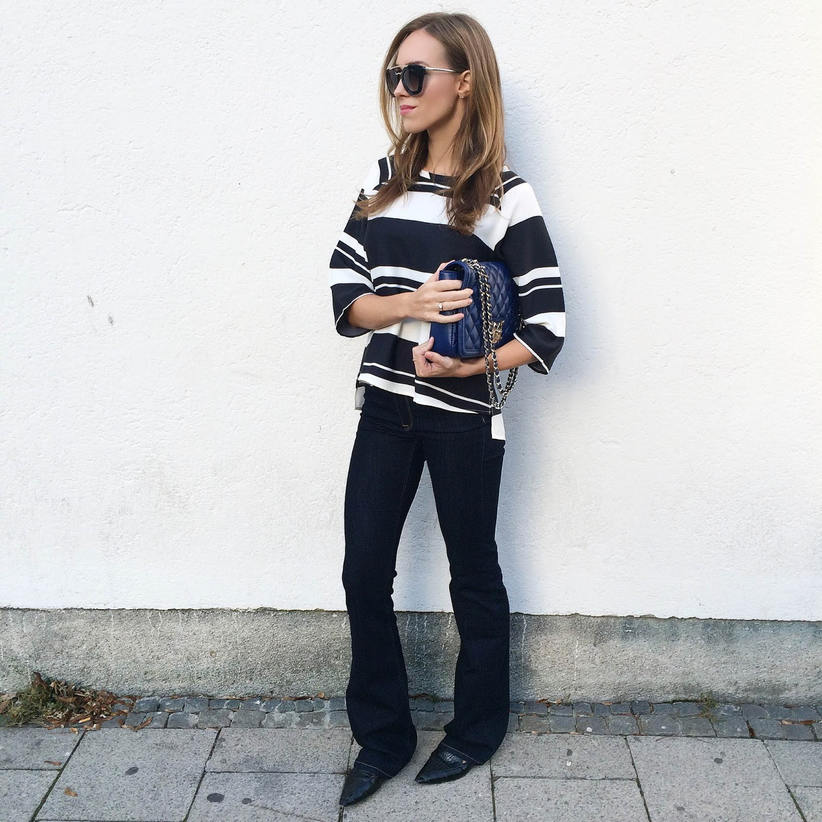 kristjaana mere striped top flare denim jeans pointed toe flats outfit
