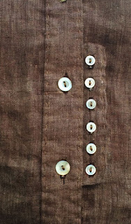 Vintage pearl buttons in two sizes set off this extra front shirt band detail in brown linen with hand topstitching