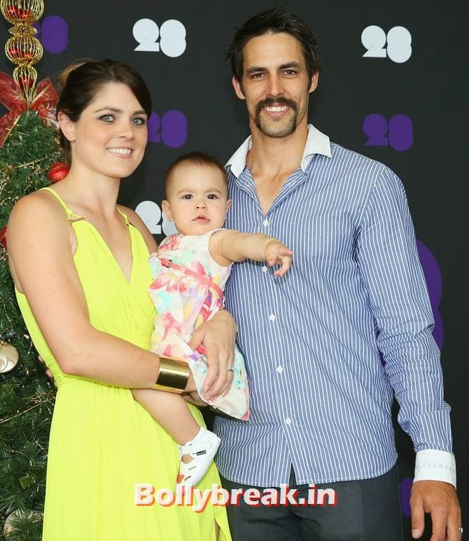Mitchell Johnson of Australia poses with his wife Jessica Bratich-Johnson and daughter Rubika, Australian Cricketers WAGS