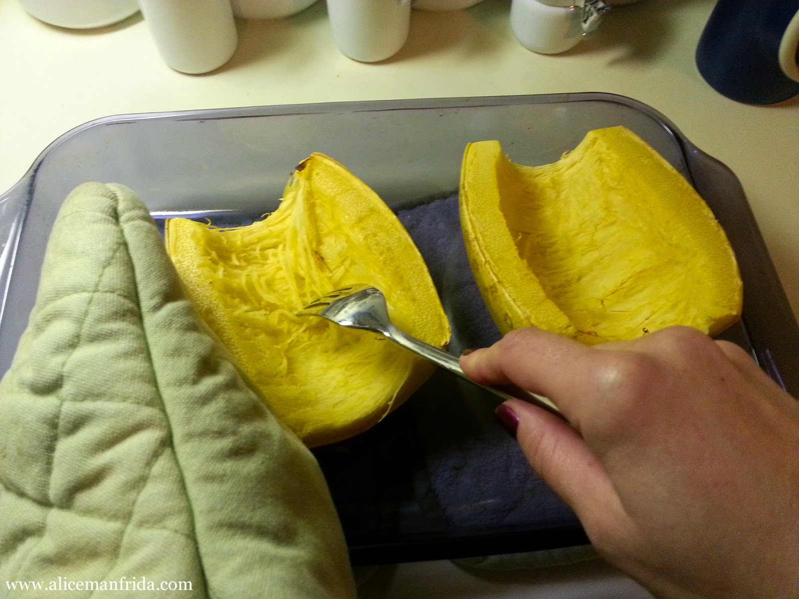 Use a fork to scrape the spaghetti squash lengthwise.