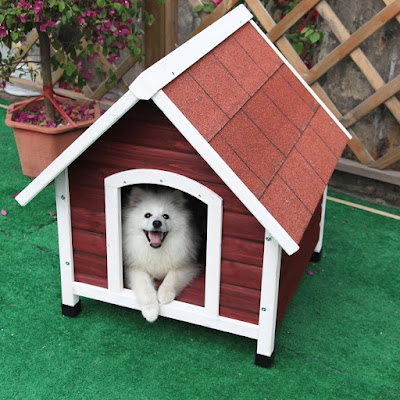 Outdoor wooden dog house with flap included